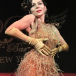 Burlesque performer Albadoro Gala in gorgeous gold, beaded dress with fringe and gold gloves, at Joe the Shark's Sharkbite Sideshow.