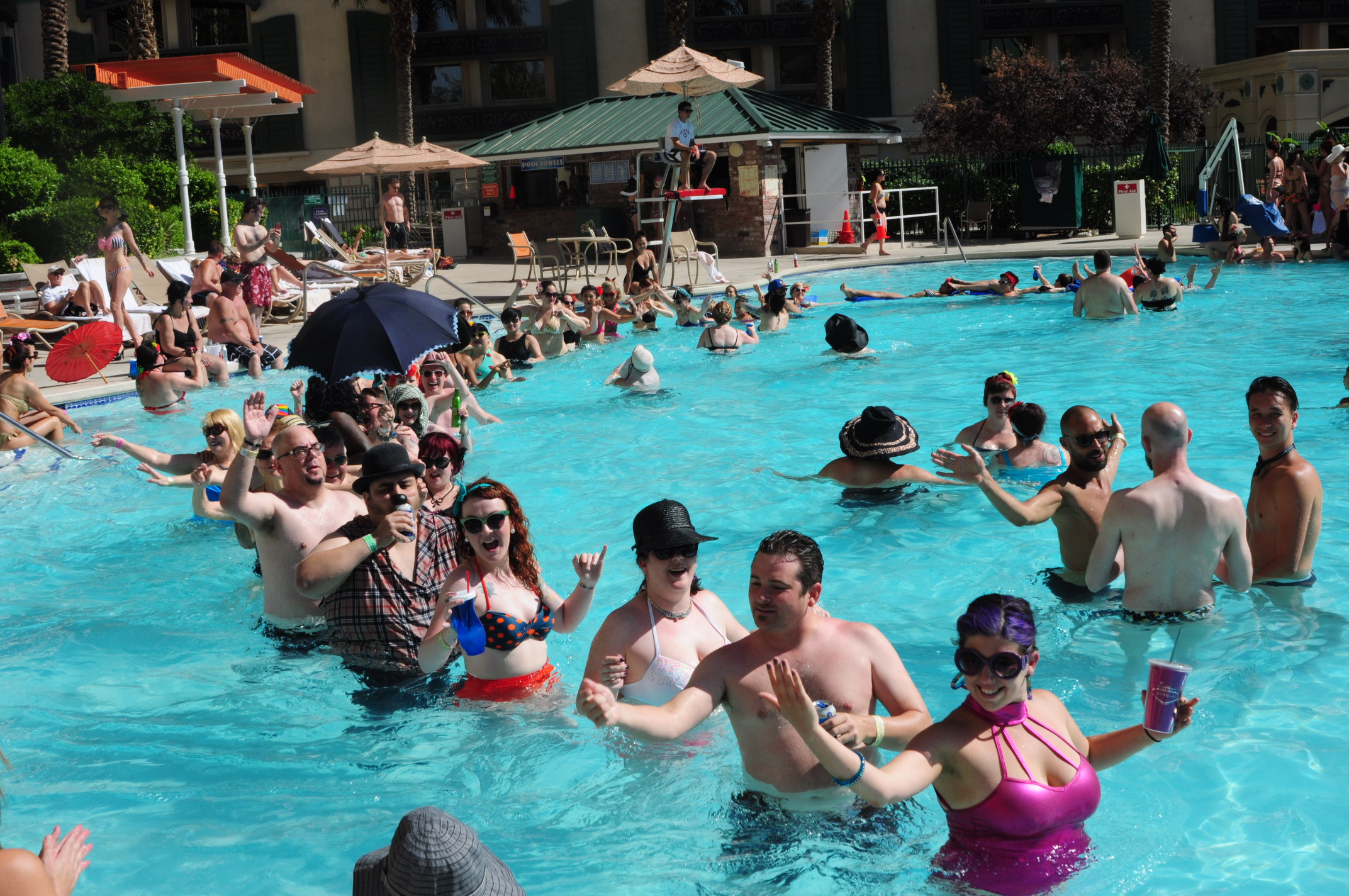 BHOF attendees doing a conga line in the swimming pool at the 2014 Sunday afternoon pool party
