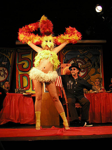 Bambi the Mermaid performing chicken routine for Dick Zigun at his 50th Birthday Party on the Coney Island Sideshow stage.
