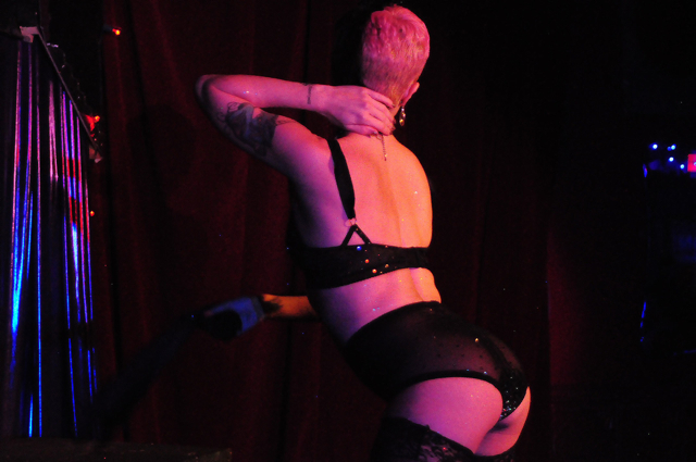 Producer Bella Blue performing at New Orleans burlesque show Dirty Dime Peep Show January 17, 2015.