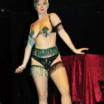 Burlesque performer Boo Bess in fabulous black and blue panties, pasties, beaded armbands, waistband, feather headpiece and fishnets, at the 2013 Coney Island Spring Gala.