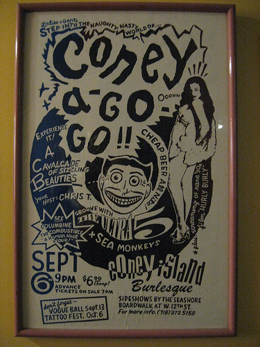 Photo of a Coney A-Go-Go poster in the Coney Island Museum, featuring an image of Billie Madley.