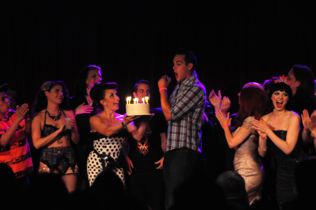 Mr. Gorgeous is presented with a birthday cake at the New York Burlesque Festival 2014 Thursday Night Teaser Show