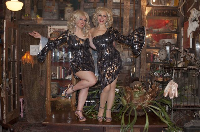 Schlep Sisters Darlinda Just Darlinda and Minnie Tonka in the coffee table that was their first stage, a decade ago.