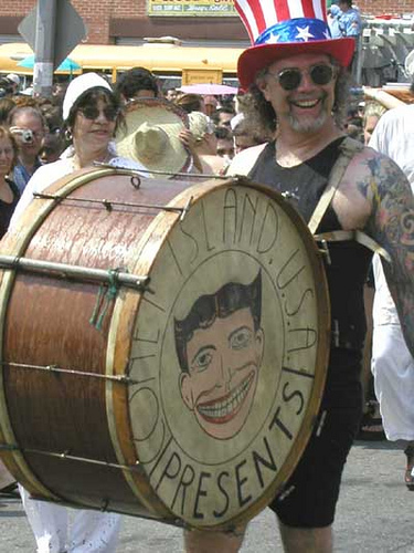Dick Zigun leads the 2002 Mermaid Parade, marching with the Coney Island USA drum.
