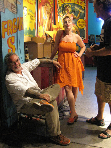Dick Zigun sits in front of the entrance to the Coney Island USA Sideshow.