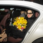 Dita Von Teese gets out of the car with yellow bouquet