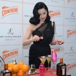 Dita Von Teese mixes a cocktail with cointreau at Be Cointreauversial party in New Delhi, India