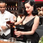 Dita Von Teese mixes a cocktail with cointreau at Be Cointreauversial party in Bangkok