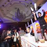 Bartender juggles bottles at Be Cointreauversial party in Bangkok, Thailand