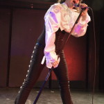Don DickRealis performing at the Prince burlesque tribute show, Quintessential: The Purple Rain Edition.