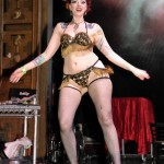Burlesque performer Dottie Dynamo shakes it in black and gold fringe panties and bra and black fishnets, at the 2013 Coney Island Spring Gala.