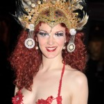 Foxy Vermouth poses for the camera in gorgeous gold and feather headpiece and red and gold top at the 2013 Coney Island Spring Gala.