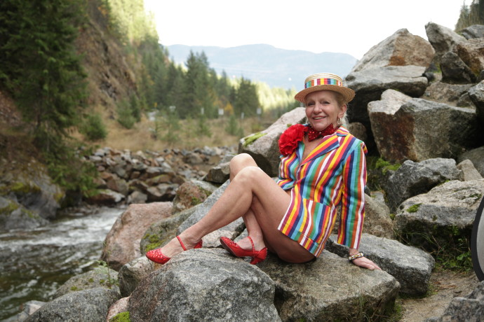 Burlesque legend Judith Stein posing on a rock