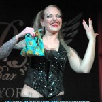 Sword swallower Kryssy Kocktail in black sequined corset at Joe the Shark's Sharkbite Sideshow.