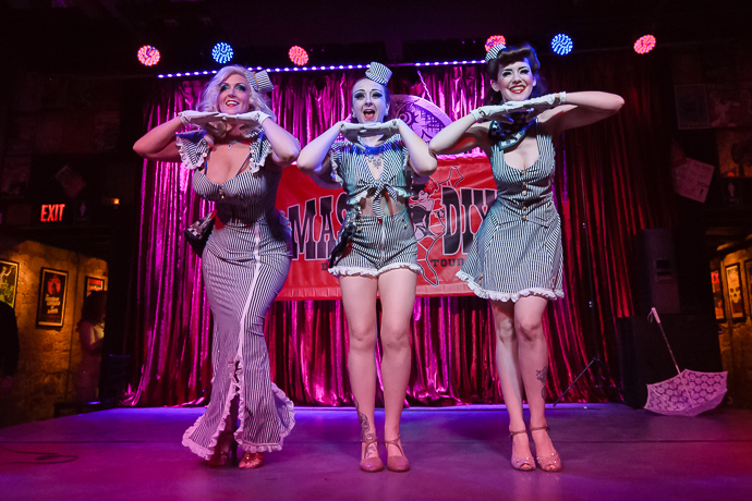 Producers Deanna Danger, Üla Überbusen, Hazel Honeysuckle​ performing at the Mason Dixie Burlesque Tour on February 26, 2015 at Three Links, Dallas, Texas