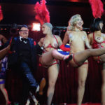 Murray Hill onstage with Missy Lisa and her troupe at The 2017 New York Burlesque Festival Saturday night show at BB Kings.