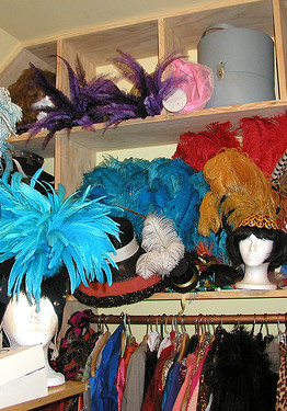 The shelves of Paula the Swedish Housewife's Closet, packed with headpieces and hats and lots of pieces made up of feathers.