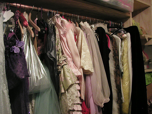 Burlesque performer Paula the Swedish Housewife's closet rack is stuffed with gowns and robes and dresses.