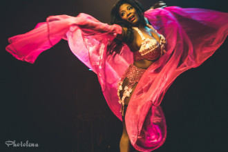 Perle Noire performing at the 2015 Toronto Burlesque Festival teaser show, Crystal Menagerie