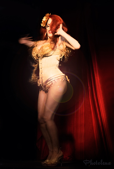 Jo Boobs Weldon performs her tribute act to Gypsy Rose Lee, twirling gold fringe, at Toronto burlesque show, Girlesque.