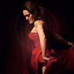Maria Juana performs at Toronto burlesque show, Girlesque, wearing a deep red dress.