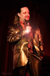 Jonny Porkpie wears a spectacularly shiny gold suit, emceeing at the Toronto burlesque show, Girlesque.