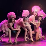 The Harlettes perform wearing feathers and fabulous headpieces, at the Toronto burlesque show, Girlesque.