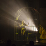 performer walking out of a giant prop cage at the premiere Prague Burlesque Show