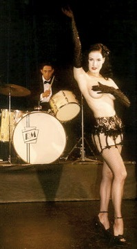 Musician Ronnie Magri with burlesque performer Dita Von Teese; Photo by Rick Delaup