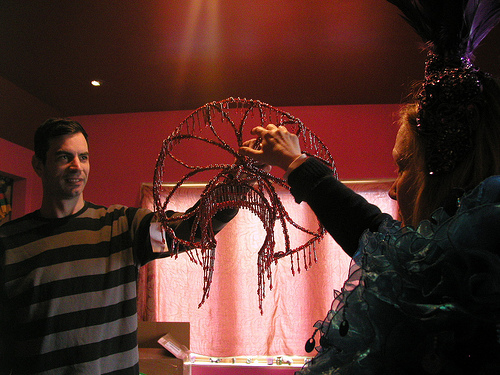 Scott Ewalt presents a new beaded headdress to burlesque performer Paula the Swedish Housewife.