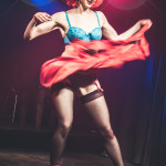 Seedy Edie performing at Peepshow TO's Twin Peaks Burlesque: Fire Strip With Me, in Toronto