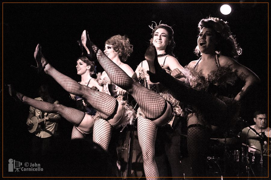 Seattle Burlesque Troupe, Sinner Saint Burlesque (from left) Captain Panto (banjo player), Polly Wood, Evilyn Sin Claire, Jesse Belle Jones and Lady TaTas, with drummer  Lord Kamke