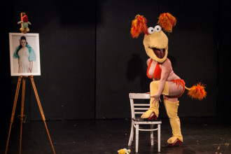 Rosey La Rouge performing at the 2015 Burlesque Blitz Muppet Burlesque Show at the Kraine Theater, New York