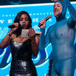 "Orange is the New Black actress Jessica Pimentel announces the ""Performer Most Likely to Get Cast on Orange is the New Black"" award at the New York Burlesque Festival Golden Pastie Awards. Scotty the Blue Bunny, the evening's host, stands to her left."
